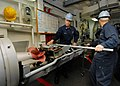 US Navy 080217-N-5476H-016 Gunner's Mate 1st Class Kacy Rupp, left, and Gunner's Mate 3rd Class Andrew Putman remove a MK46 torpedo from the MK32-MOD14 service vessel torpedo tube.jpg
