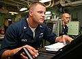 US Navy 080712-N-6764G-090 Damage Controlman 3rd Class Kaleb Brack monitors the damage control console in damage control central.jpg