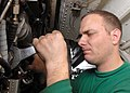 US Navy 081129-N-2456S-045 Aviation Machinist's Mate 2nd Class Ed Bryk, assigned to VAQ-141, installs a fuel temperature transmitter on an EA-6B Prowler in the hangar bay aboard the aircraft carrier USS Theodore Roosevelt (CVN.jpg