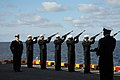 US Navy 090110-N-2439G-085 Sailors aboard the amphibious assault ship USS Wasp (LHD 1) fire a rifle volley during a burial at sea. Twelve former service members were interned during the ceremony off the coast of North Carolina.jpg
