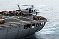 US Navy 090530-N-5402T-045 An SH-60F Seahawk helicopter assigned to the Indians of Helicopter Anti-Submarine Squadron (HS) 6 lifts palettes from the deck of the Military Sealift Command fleet replenishment oiler USNS Yukon (T-A.jpg