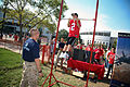 US Navy 090905-N-3271W-129 A young Buckeyes fan demonstrates his chin-up skills at a U.S. Marine Corps display alongside the Navy's F-A-18 Hornet flight simulator before the U.S. Naval Academy and Ohio State University football.jpg