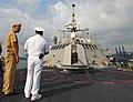 US Navy 100326-N-7058E-249 Lt. Cmdr. Matt Weber, executive officer of the littoral combat ship USS Freedom (LCS 1), describes the ship's Mk 110 57mm gun.jpg