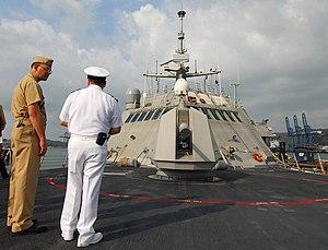 Military attaché - Image: US Navy 100326 N 7058E 249 Lt. Cmdr. Matt Weber, executive officer of the littoral combat ship USS Freedom (LCS 1), describes the ship's Mk 110 57mm gun