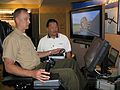 US Navy 101005-N-2222V-001 System Engineer Larry Nakamura, from Boeing Training Systems Group, instructs Maj. Christian Ward.jpg