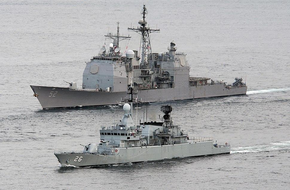 US Navy 110126-N-7981E-422 The Royal Malaysian Navy frigate KD Lekir (FF 26) leads the Ticonderoga-class guided missile cruiser USS Bunker Hill (CG