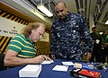 US Navy 110211-N-8040H-014 Stand-up comedian Gallagher signs an autograph for Chief Yeoman Martiano Magana on the mess decks aboard the Nimitz-clas.jpg