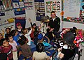 US Navy 110302-N-5647H-052 Aviation Electrician's Mate Airman Matthew DeAngelo answers questions from children at Plympton Elementary School to cel.jpg