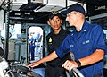 US Navy 110822-N-XR557-099 Boatswain's Mate 3rd Class Mark Denton, right, talks to Republic of Singapore navy 2nd Lt. Dominic Lew.jpg