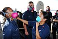 US Navy 111101-N-KF029-025 Damage Controlman 1st Class Rebecca Thomas, from San Antonio, uses irritant smoke to test the seal of a respirator durin.jpg