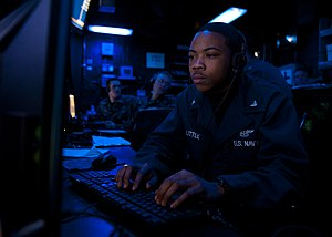 US Navy 120128-N-FI736-887 Air Traffic Controller 3rd Class Tyrell Little stands watch aboard the aircraft carrier USS Enterprise (CVN 65).jpg