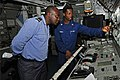 US Navy 120209-N-IZ292-079 Gas Turbine System Technician (Mechanical) 3rd Class Botha Nzinga explains the propulsion control console aboard the gui.jpg