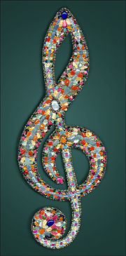 Treble clef with gemstones