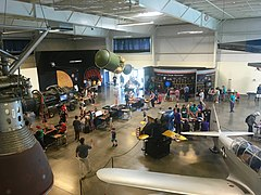 Visitors inside the Exhibit Hall at the Aerospace Museum of California near the space exhibits.jpg
