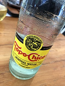A glass bottle of Topo Chico