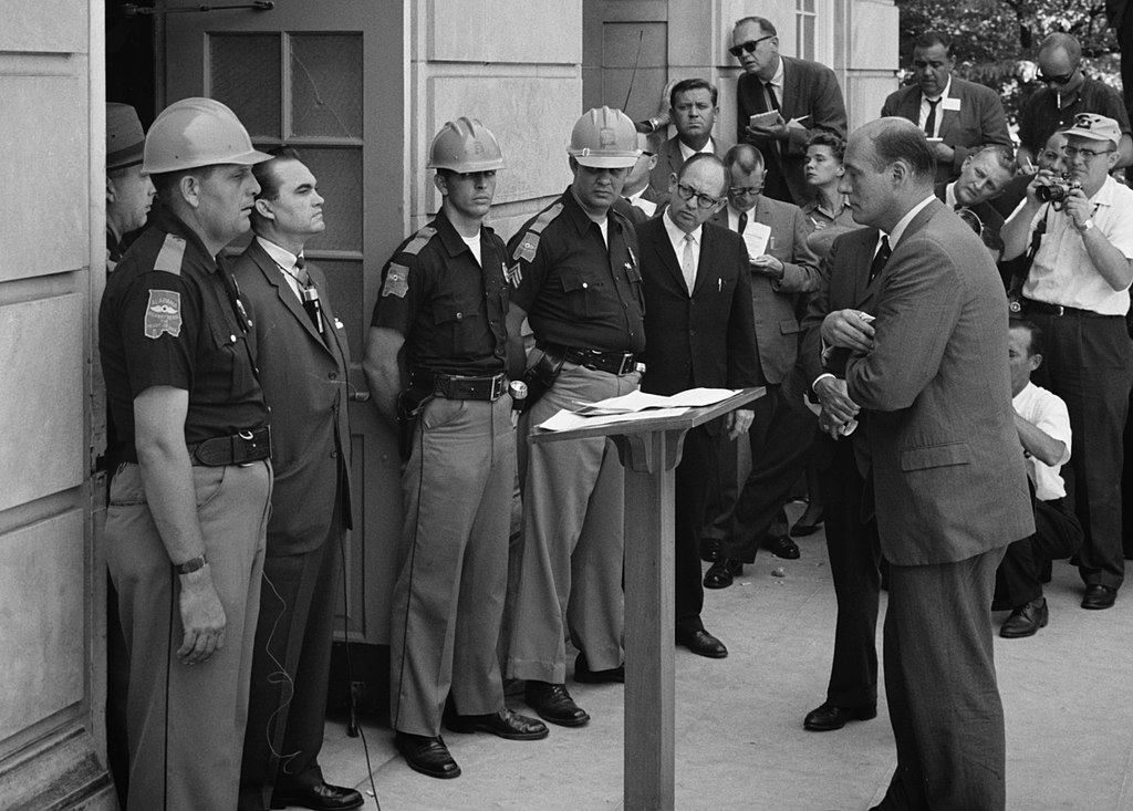 George Wallace standing defiantly in the doorhouse of the University     of Alabama.