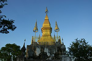 Phou si - The gilded stupa of Wat Chom Si on the summit of Mount Phou Si.