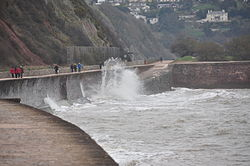 Waves breaking on the sea wall at Teignmouth (0117).jpg