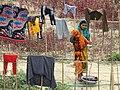 Woman Hanging Clothes along Shangu River - Chittagong Hill Tracts - Bangladesh (13184968345).jpg