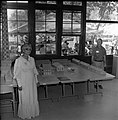 Woman and man stand near an indoors diorama of pioneer homes at the first annual Folklife Festival, Zion National Park Nature (a8df11ec180642ca80ed5492efde413b).jpg
