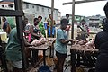 Workers plucking chickens in a market.jpg