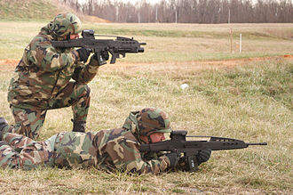 Heckler & Koch XM8 - XM8 testing; One shooter is kneeling with an XM8 Carbine and a XM320 (a 40 mm grenade launcher) attached, while the other uses the XM8 sharpshooter (designated marksman) variant.