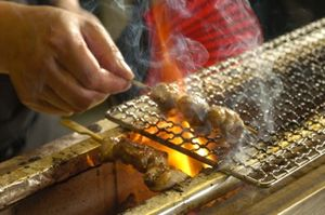 Yakitori cooking over Bincho coals
