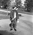 Young student waiting on School Bus Oak Ridge 1968 (9734607469).jpg