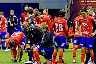 Östers IF - The team during a pregame warmup in 2012 wearing their traditional red and blue kits.