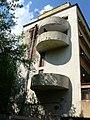 Дом Наркомфина, торец с полукруглыми балкончиками.JPG