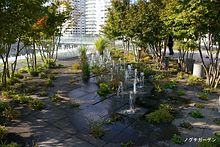 Urban garden with trees and small fountains