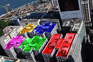 Chungking Mansions - Aerial view of Chungking Mansions. Roof colors added:  A-red, B-green, C-purple, D-blue, E-yellow. Nathan Road is on the far right side.