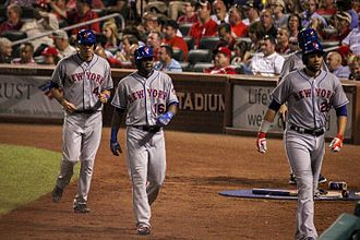 2016 New York Mets season - Left to right: Wilmer Flores, Alejandro De Aza and James Loney of the New York Mets walk to the dugout. (2016)