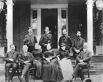 John Collins Covell - Faculty and staff at the West Virginia Schools for the Deaf and Blind in 1884. Standing left to right: Mr. Shaeffer, Principal John Collins Covell, Abraham D. Hays, and math professor E. L. Chapin. Seated left to right: school founder Howard Hille Johnson, J. B. McGann, Lulie Kern, Martha Clelland, Sarah Caruthers, and principal of the deaf school, H. H. Chidester.