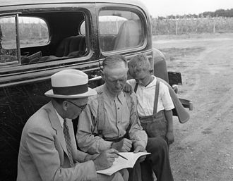 Agricultural Adjustment Act - A Roosevelt County New Mexico farmer and a County Agricultural Conservation Committee representative review the provisions of the Agricultural Adjustment Act (AAA) farm program to determine how it can best be applied on that particular acreage in 1934.