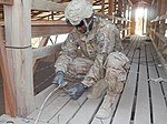 82nd SB-CMRE troops deconstruct former Canadian prison compound in Afghanistan 131127-A-ZZ999-004.jpg