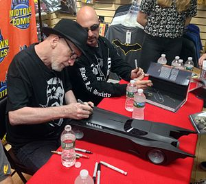 Batmobile - Comics creators Frank Miller and Greg Capullo sign a toy Batmobile based on the animated series during an appearance at Midtown Comics.