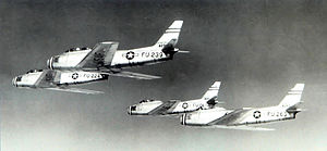 93d Fighter-Interceptor Squadron - A 93d Fighter-Interceptor Squadron 4 F-86A overflight of Kirtland AFB, New Mexico in 1951. Identified Aircraft are: 48-239, 48-224, 48-263 and 49-1061