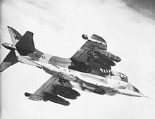 A Harrier in flight, with large weapons loadout underneath