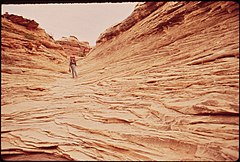A Hiker in the Maze, a Remote and Rugged Region in the Heart of the Canyonlands, 05-1972 (3856294057).jpg