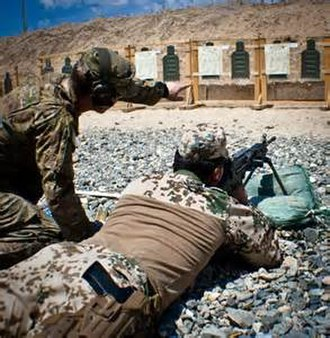 125th Infantry Regiment (United States) - Ethan Bednar, a rifleman with Company A, 1st Battalion, 125th Infantry assists a German infantryman, assigned to Task Force Kunduz, firing a M249 light machine gun during range fire at Forward Operating Base Kunduz, Afghanistan