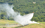A crew of a CH-47 Chinook helicopter drops water from a Bambi Bucket during Vibrant Response 140724-A-PU919-033.jpg