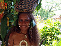 A girl in traditional dress with a basket on her head at the Commonwealth Youth Program (CYP) offices in Honiara. (10662154623).jpg