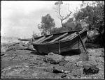 A rowing boat pulled ashore on a rock shelf (3640342928).jpg