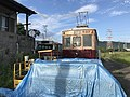 Abandoned tramcar and bus near Chikuzen-Yamae Station.jpg