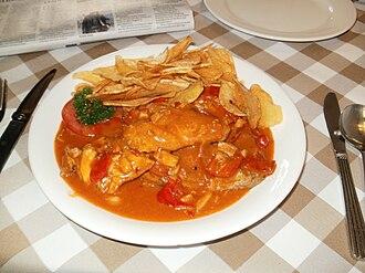 Galinha à africana - galinha à Africana with fresh potato chips, as served near A-Ma Temple in Macau