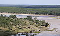 African elephants from a distance at the Oiliphants River, Kruger Park (12255771486).jpg