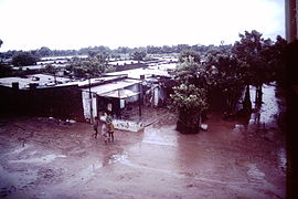 Ahmedabad-India-slums-1979-IHS-89-16-Slum in-the-rain.jpeg