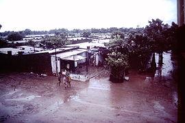 Ahmedabad-India-slums-1979-IHS-89-16-Slum in-the-rain.jpeg
