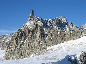 Dent du Géant - The sharp pinnacle of the Dent du Géant (left) at the western end of the Rochefort ridge (centre)